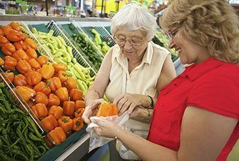 an elderly woman in a grocery shopping