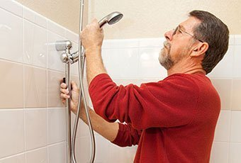 man-fixing-shower-340