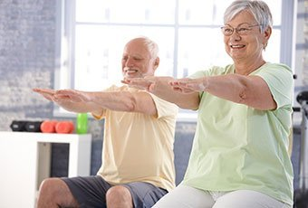 elderly couple practising physical exercise