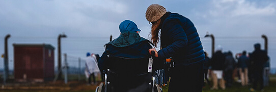woman talking to a person in a wheelchair